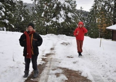Sage and Nicolas make their way to the meditation hall after the first winter storm.