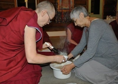 Tanya helps Venerable Tarpa serve hot oatmeal as the first meal on the last day of retreat.