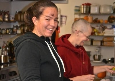 Rachel enjoys helping Venerable Thubten Chonyi in the kitchen.