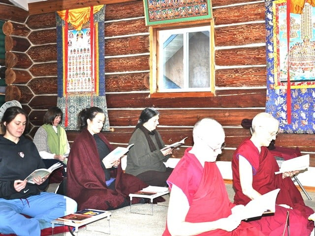 The community and guests recite Shantideva's Guide to Bodhisattva's Way of Life on Christmas Day in the Meditation Hall.