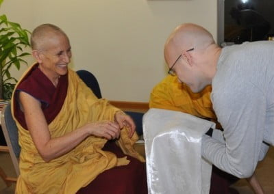 Clinton, who recently moved to the Abbey, makes an offering to Venerable Thubten Chodron after requesting training.