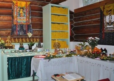 Many lovely abundant offerings are presented to Lama Tsongkhapa.
