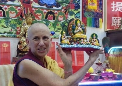 Venerable Thubten Chodron displays an offering for the Abbey: Je Rinpoche and his heart disciples.