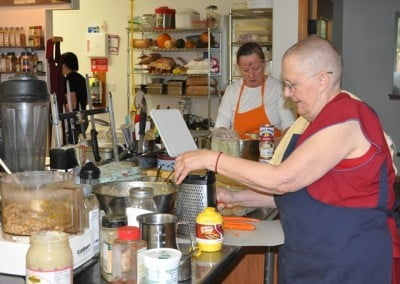 Venerable Thubten Jigme makes her famous nut loaf, while Donna contributes Louisiana bread pudding.