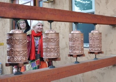 Tree's mom, Summer, was curious and intrigued by the prayer wheels.