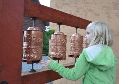 Ezran turns the prayer wheels, sending millions of compassion mantras into the world.
