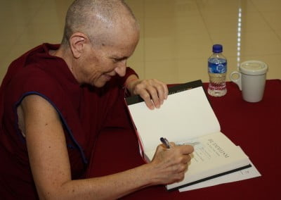 Ven. Chodron signs the new book, Buddhism: One Teacher, Many Traditions.