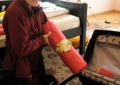 A Buddhist nun packs a suitcase