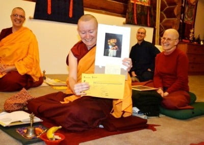 A Buddhist nun displays gifts