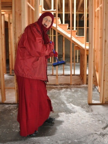 Venerable Tarpa's dedication to keeping the Chenrezig Hall work site free of snow, ice, slush, and water is truly inspiring!