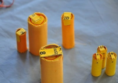 A collection of completed mantra rolls.