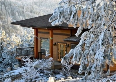 Gotami House surrounded by snow dusted trees.