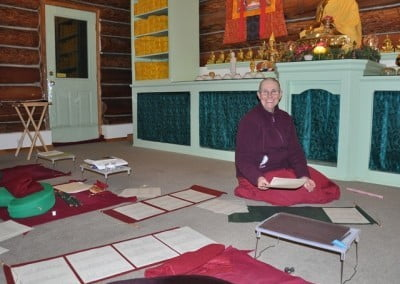 Venerable Thubten Chonyi prepares the names of our Singapore friends and supporters in celebration of Chinese New Year.