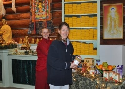 Heather and Venerable Thubten Jampa combine their talents in making many offerings including lights, food, and water bowls for the Tara puja.