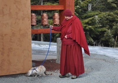 Venerable Thubten Tsultrim and Karuna during a daily walk by the prayer wheels.