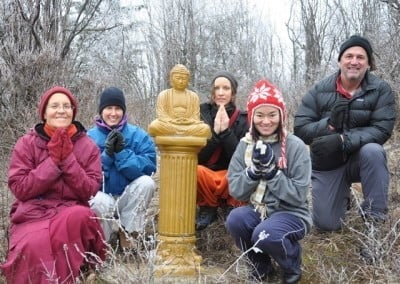 Venerable Thubten Semkye, Heather, Alex, Minh and David pay their respects to the Buddha.