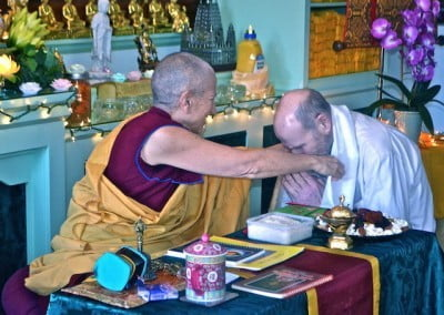 Tommy receives his khata back from Venerable Chodron.