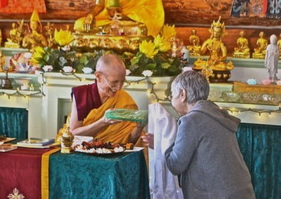 Venerable Chodron offers one of the tsa-tsas to Tanya.