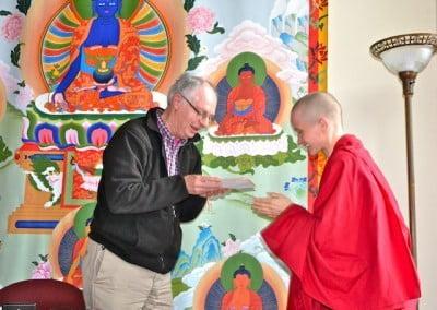 A Buddhist nun gratefully speaks to a man