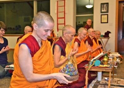 A Buddhist nun offers a mandala