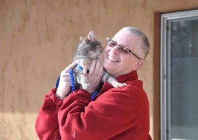 A Buddhist nun holds a cat