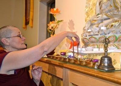 A Buddhist nun arranges offerings