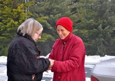 A woman talks to a Buddhist nun