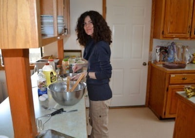 A woman works in the kitchen