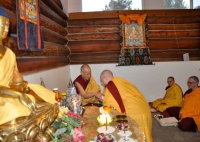 Buddhist nuns bow to each other
