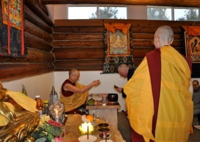 An anagarika and a Buddhist nun bow to each other