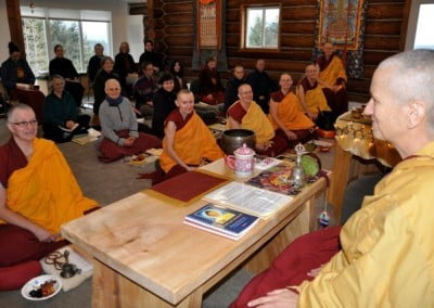 The retreatants are finally all together with Venerable Chodron in the hall to celebrate the virtue they created and to dedicate it for the benefit of all beings.