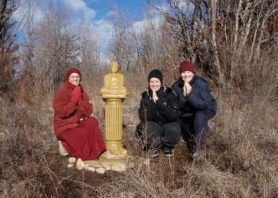 Venerable Semkye, Robin, and Mary pay their respects to the Buddha.