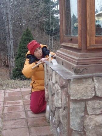 A Buddhist nun works on a statue housing