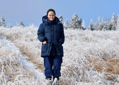 A nun-to-be, Anagarika Dani, walking down a snow covered path