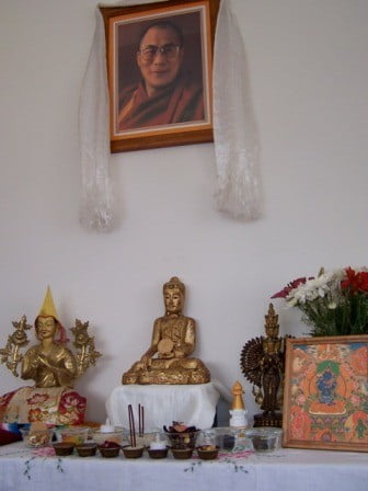 A Buddhist altar with a central statue