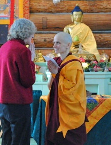 Susan Mitchell shares her joy with Venerable Jampa.