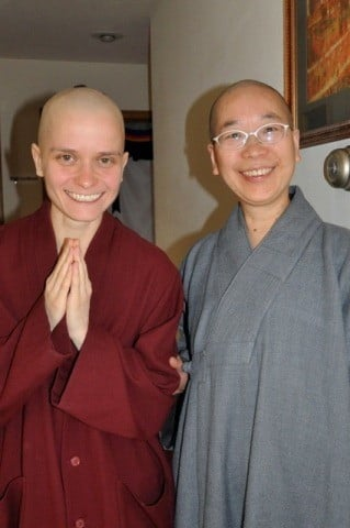 Dani and Venerable Jendy rejoice at the conclusion of the head shaving ceremony.