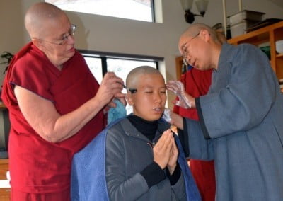 Taking the Anagarika vows at Sravasti Abbey, shaving one's head, and donning the blue outfit allow individuals to explore monastic life.