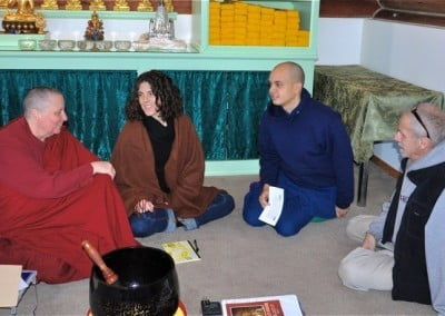 Retreatants sit in the Meditation hall for group discussion.