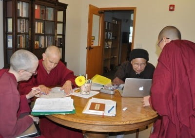 Venerables Thubten Tarpa, Chodron, Heng-ching, and Damcho check the ceremony and Abbey maps for setting the territory for the retreat.