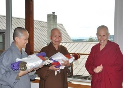 A very happy abbess presents small tokens of our gratitude to our Vinaya teachers before they depart.