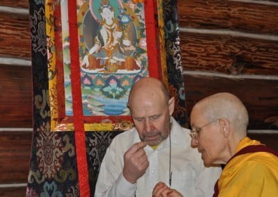 Venerable Semkye gives some simple instructions to Tommy, who is doing tsog for the first time at the Abbey.
