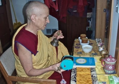 Venerable Chodron makes offerings and sets the Yamantaka participants in retreat.