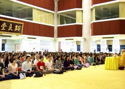 Venerable Chodron speaking to a great number of students.