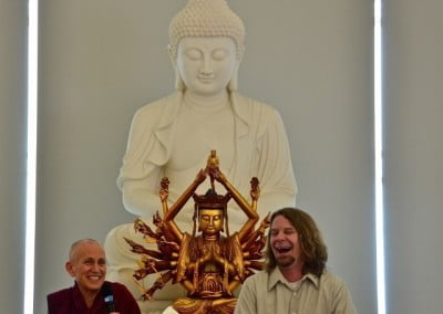 Venerable Chodron and another speaker, laughing.