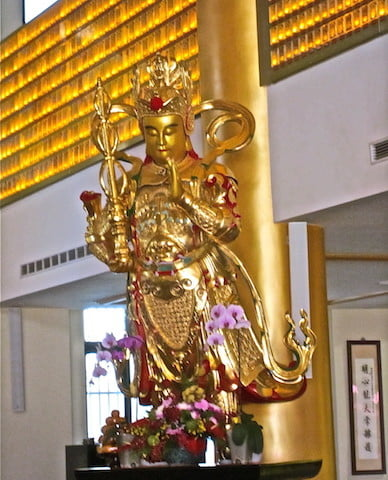 A life-size statue of Weituo Pusa, a bodhisattva regarded as a guardian of Buddhist monasteries.