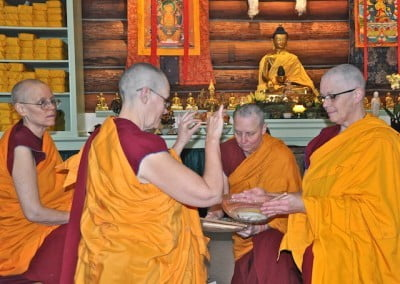 Venerable Chonyi accepts the stick, acknowledging her purity and intention to practice sincerely.