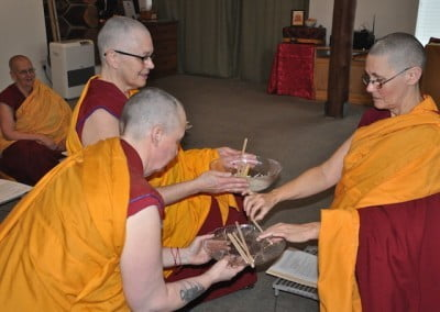 Venerable Tsultrim receives the stick, which represents Venerable Chonyi's participation in Varsa.
