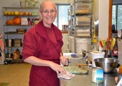 Venerable Semkye happily steps in as kitchen manager for the retreat.