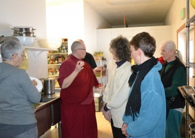 Venerable Yeshe gives a tour of the kitchen explaining where things go as to keep it tidy.